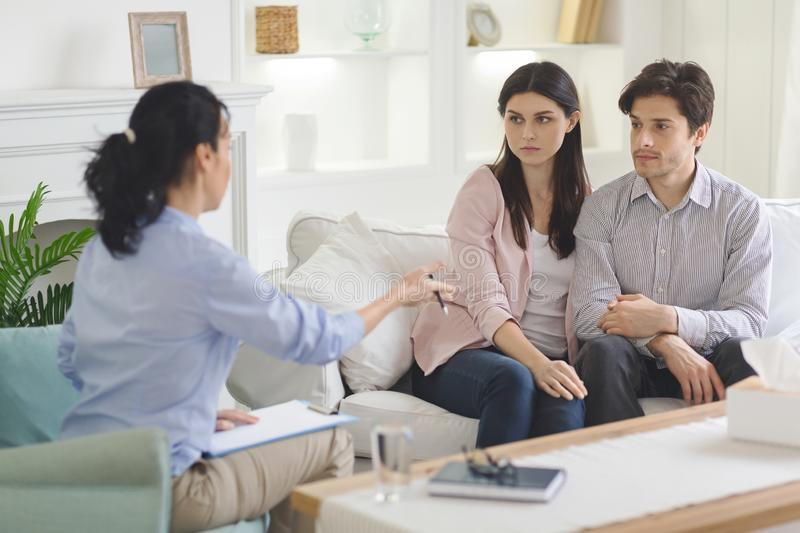 Family consultant talking to young married couple stock images