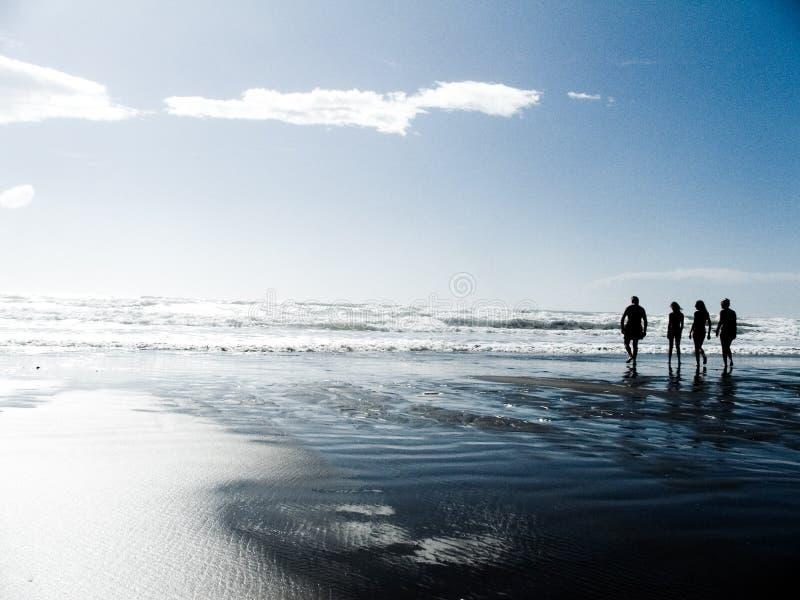 A family contemplates the sea stock photos
