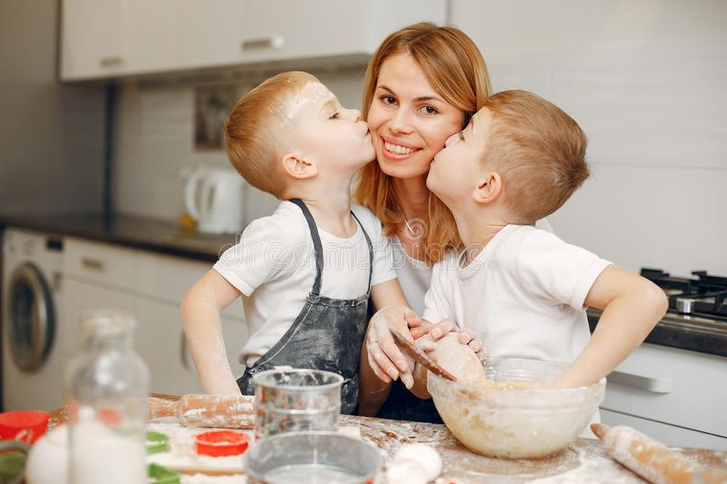 Family cook the dough for cookies royalty free stock photography