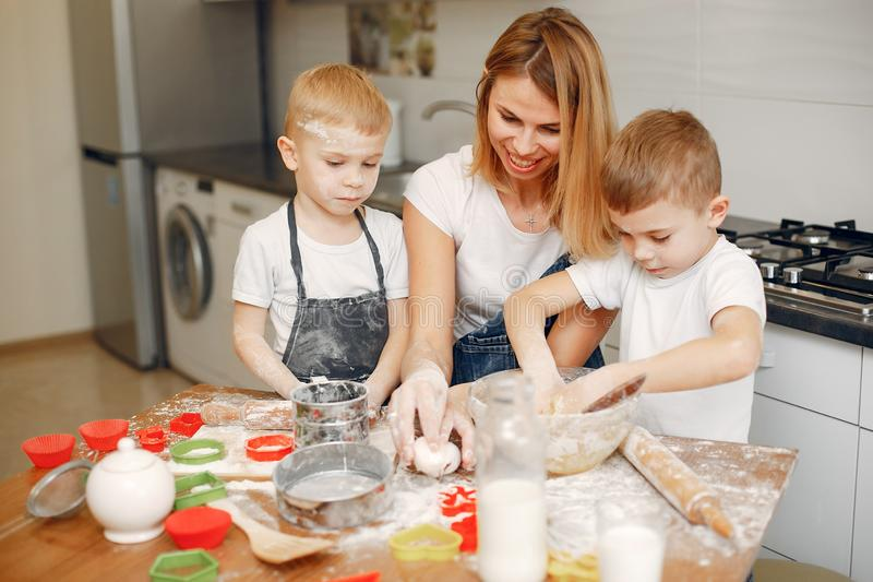 Family cook the dough for cookies stock image
