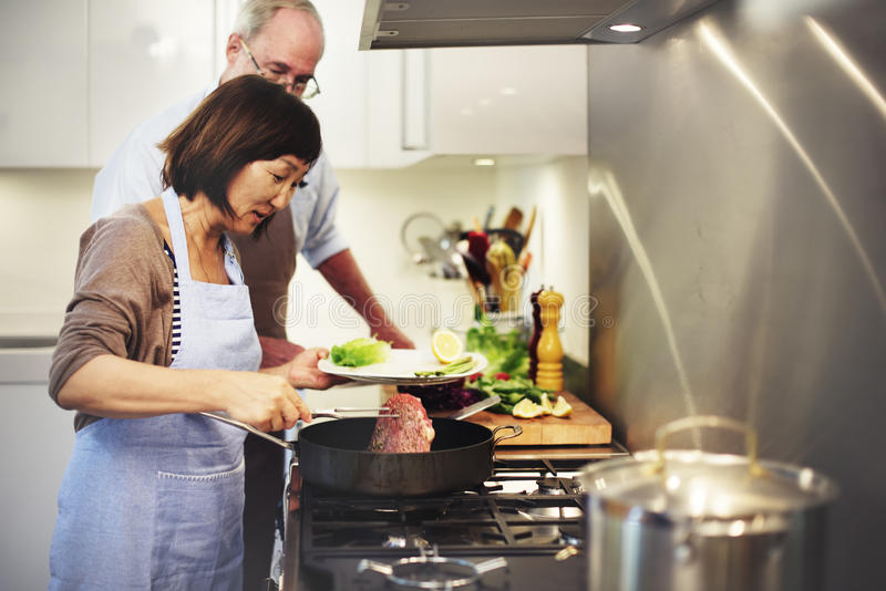Family Cooking Kitchen Food Togetherness Concept royalty free stock photo