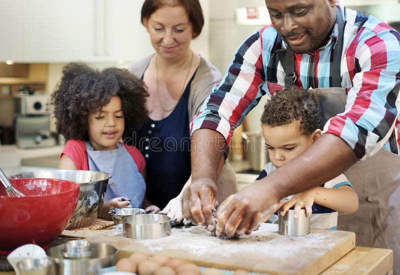 Family Cooking Kitchen Food Togetherness Concept. Family Cooking Kitchen Food Togetherness royalty free stock photography