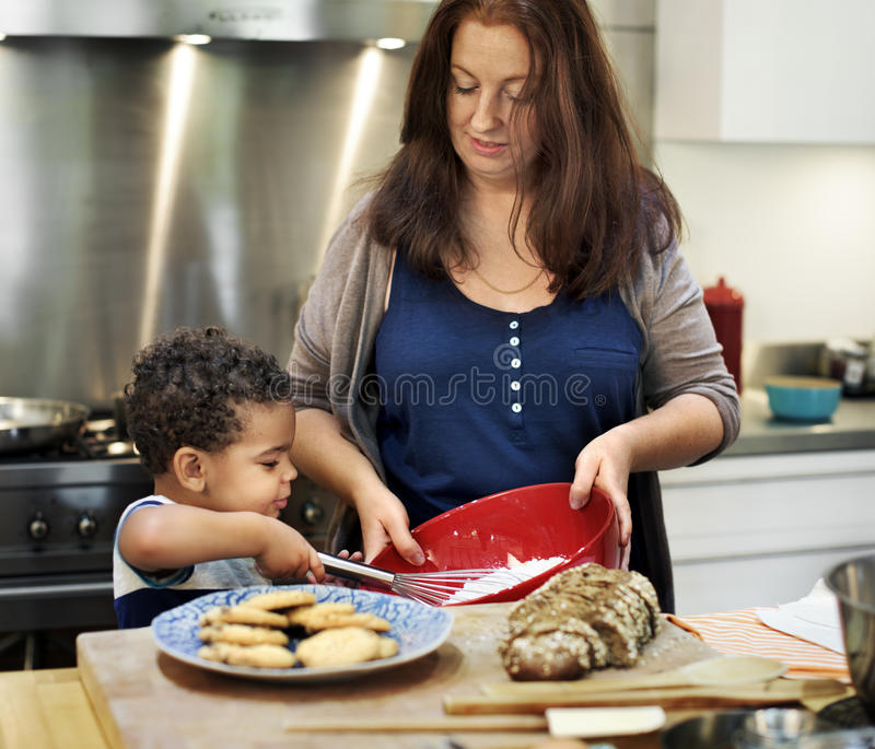 Family Cooking Kitchen Food Togetherness Concept. Family Cooking Kitchen Food Togetherness stock photos