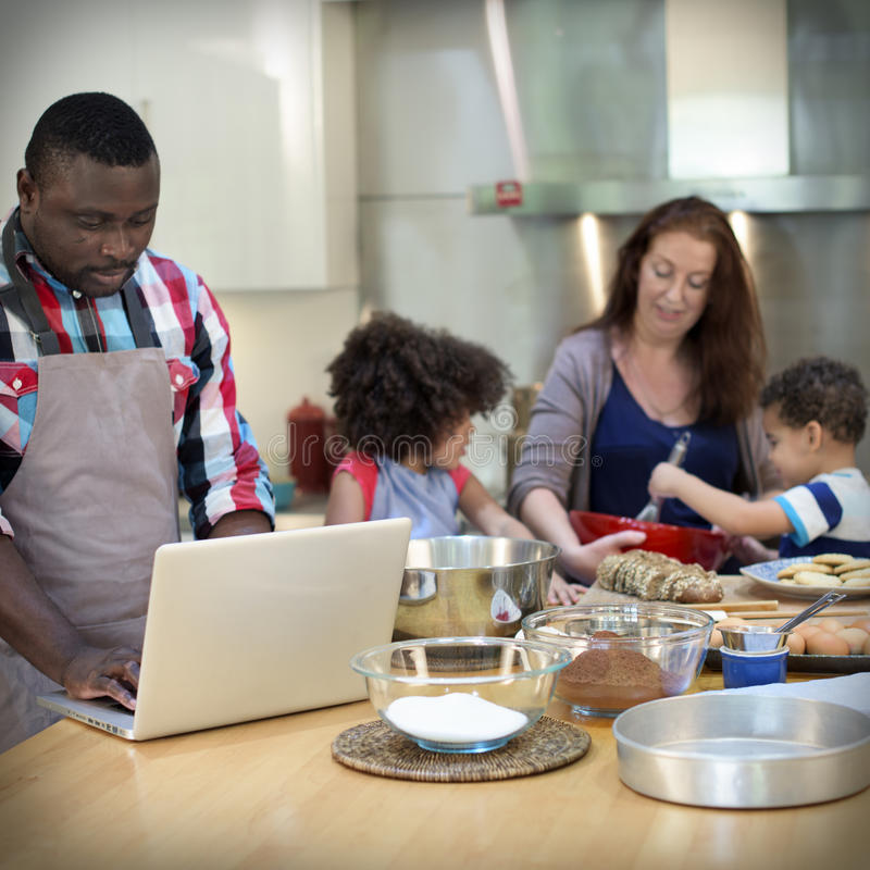 Family Cooking Kitchen Food Togetherness Concept. Family Cooking Baking Kitchen Food Togetherness royalty free stock images