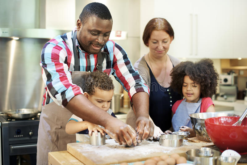 Family Cooking Kitchen Food Togetherness Concept. Family Kids Cooking Kitchen Food Togetherness stock image