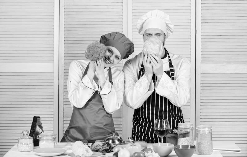 Family cooking in kitchen. vegetarian. cook uniform. happy couple in love with healthy food. Dieting and vitamin stock photos