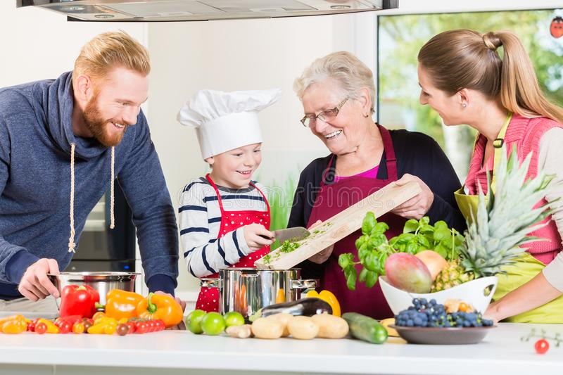 Family cooking in multigenerational household royalty free stock image