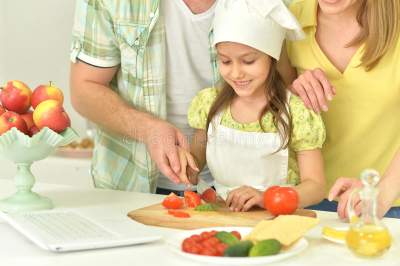 Family cooking soup. On the kitchen together royalty free stock photo