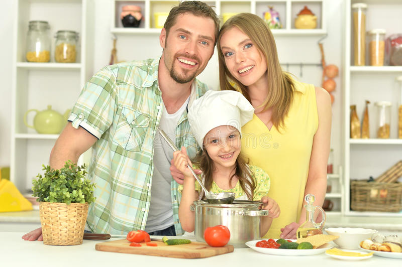 Family cooking soup. On the kitchen together stock image