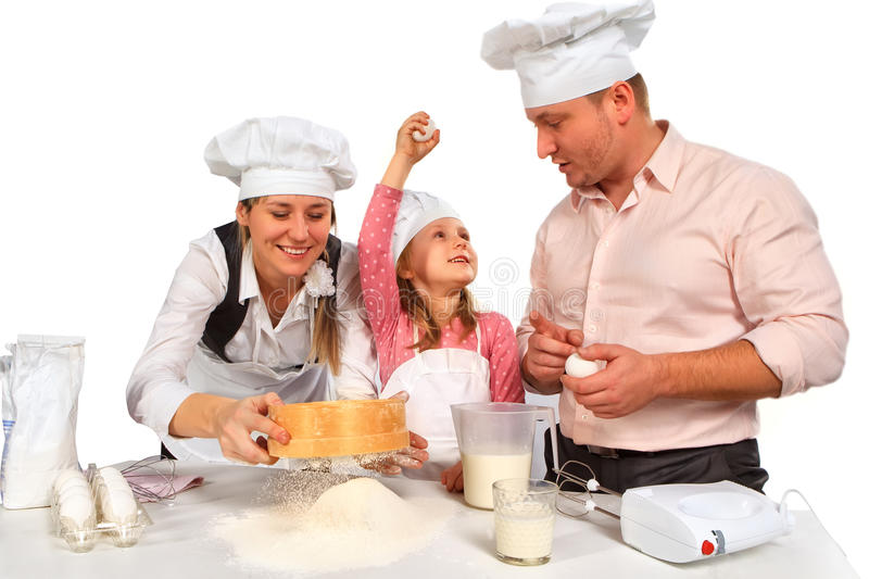 Family cooking together isolated on white. stock photo