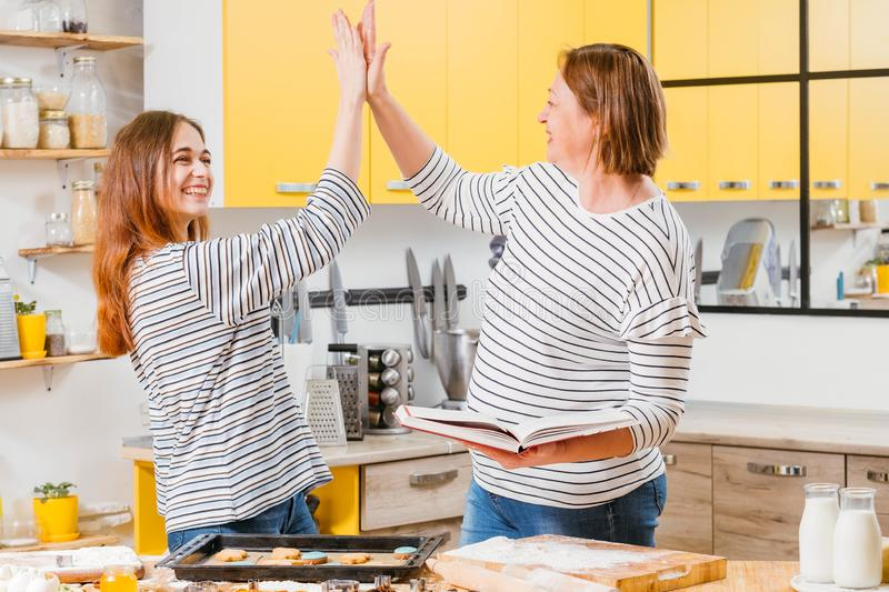 Family cooperation mother daughter high five stock photo
