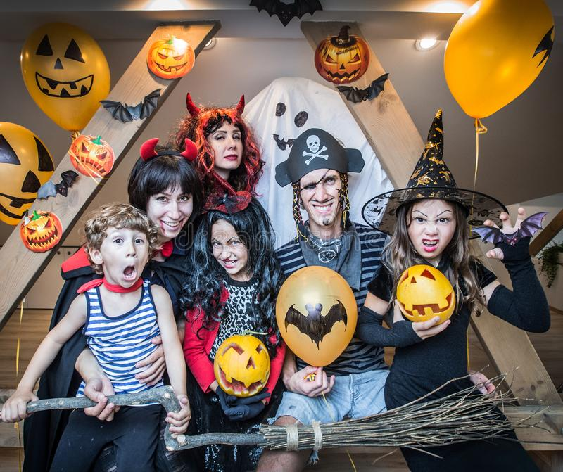 Big family in halloween costumes stock photo