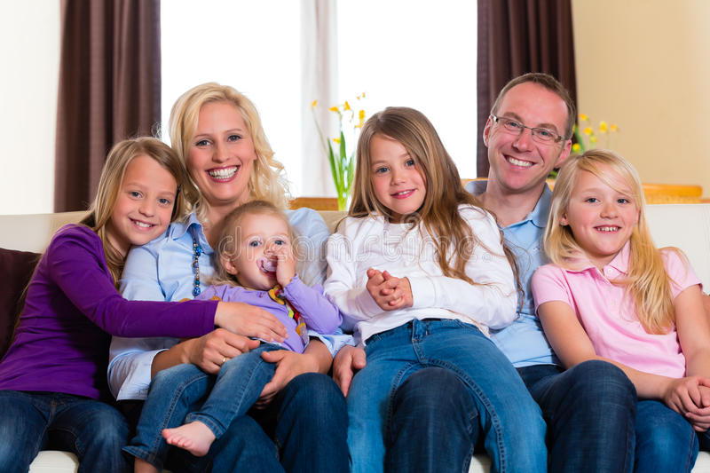 Family on a couch royalty free stock images
