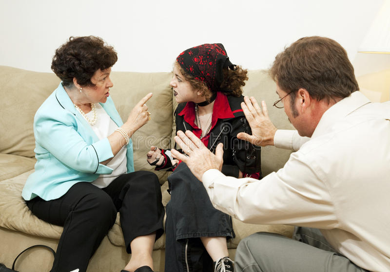 Family Counseling - Blame Daughter. Mother yelling at her teen daughter during a family counseling session stock images