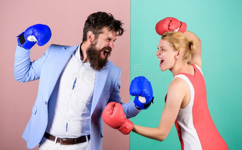 Family couple boxing gloves. problems in relationship. sport. bearded man hipster fighting with woman. Strength and stock photos