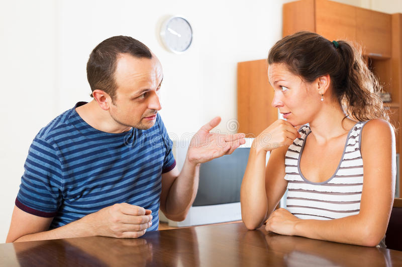 Family couple having serious conversation royalty free stock images