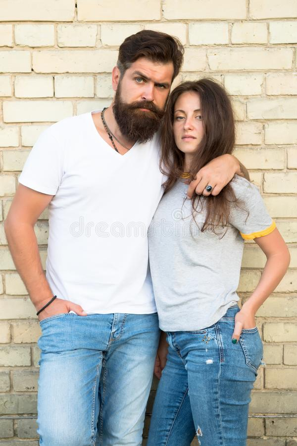Family couple hugging on brick wall background. Bearded man and sexy woman cuddling. Sensual couple together. Family day stock image