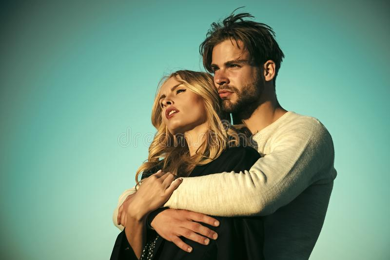 Family couple of man and girl, trust. Couple in love. Family couple of men and girl, trust. Muscular men and women with long blond hair, love. Relations of royalty free stock images