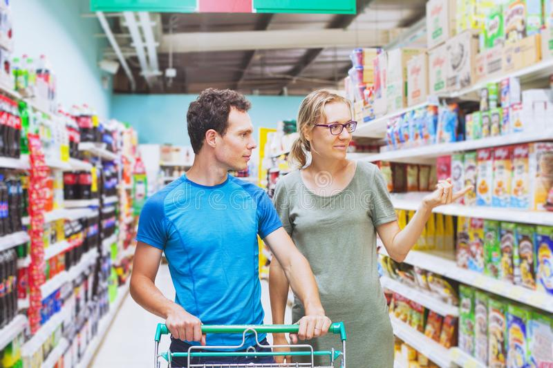 Family couple in supermarket stock photo