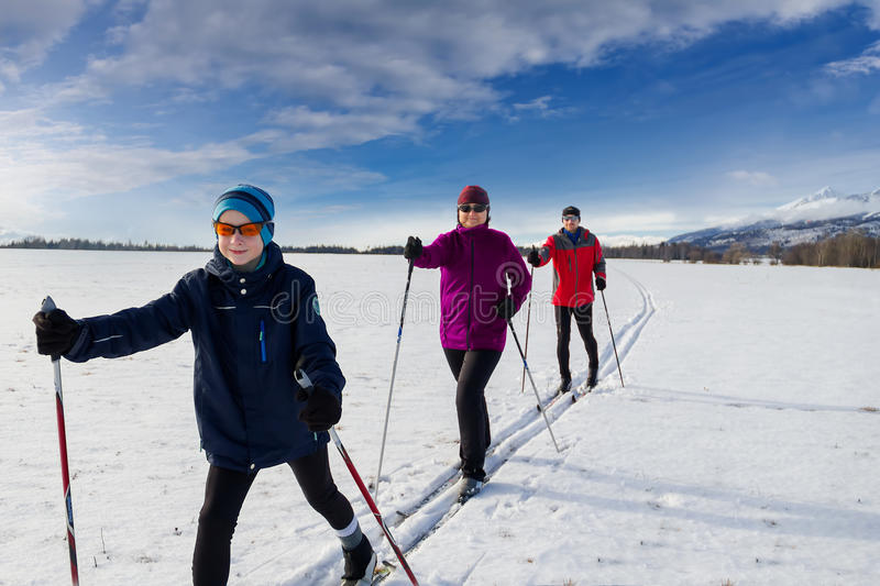 Family cross country skiing stock image