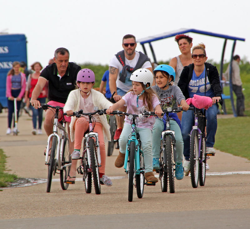 Family cycling day out. Photo of a family on a cycling day out along the coast of whitstable in kent england. photo taken 24th may 2015 and ideal for keep fit stock images