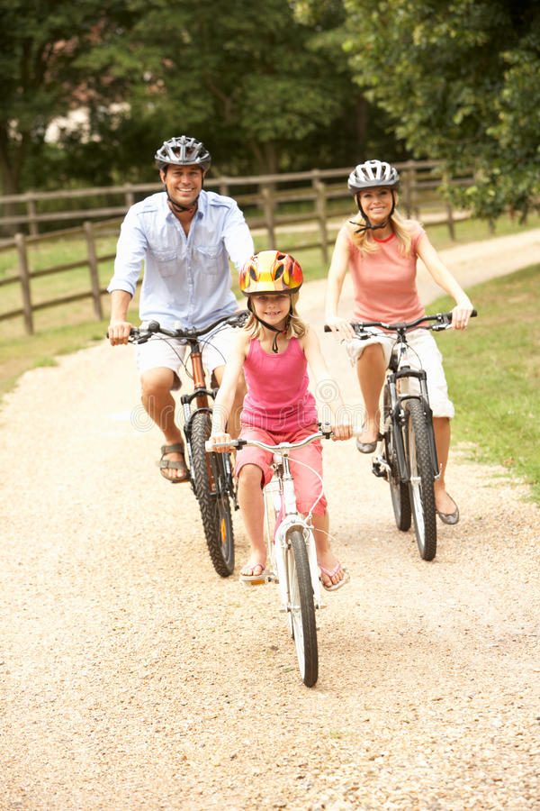 Free Family Cycling In Countryside Wearing Safety Helme Royalty Free Stock Photos - 15555638