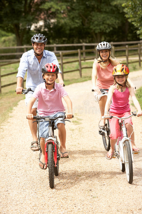 Free Family Cycling In Countryside Wearing Safety Helme Royalty Free Stock Photos - 15555728