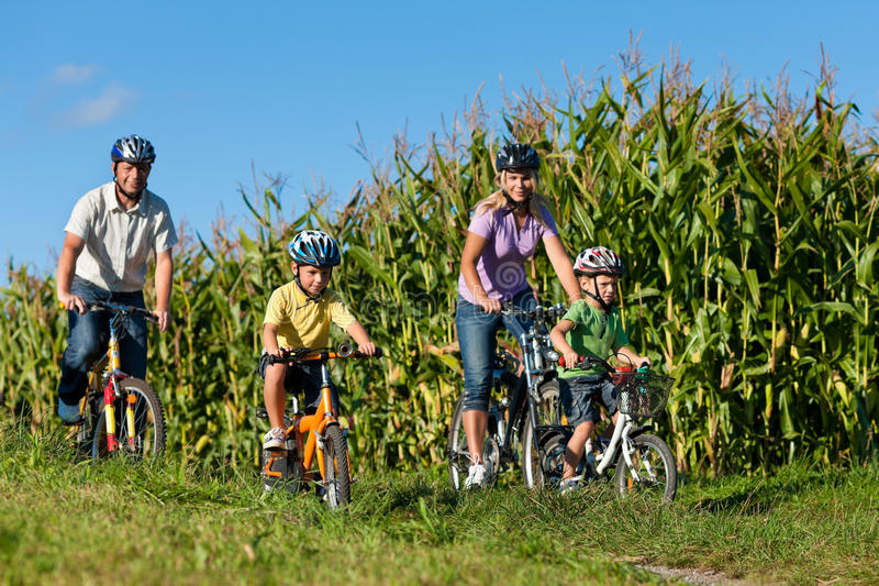 Family is cycling in summer royalty free stock images