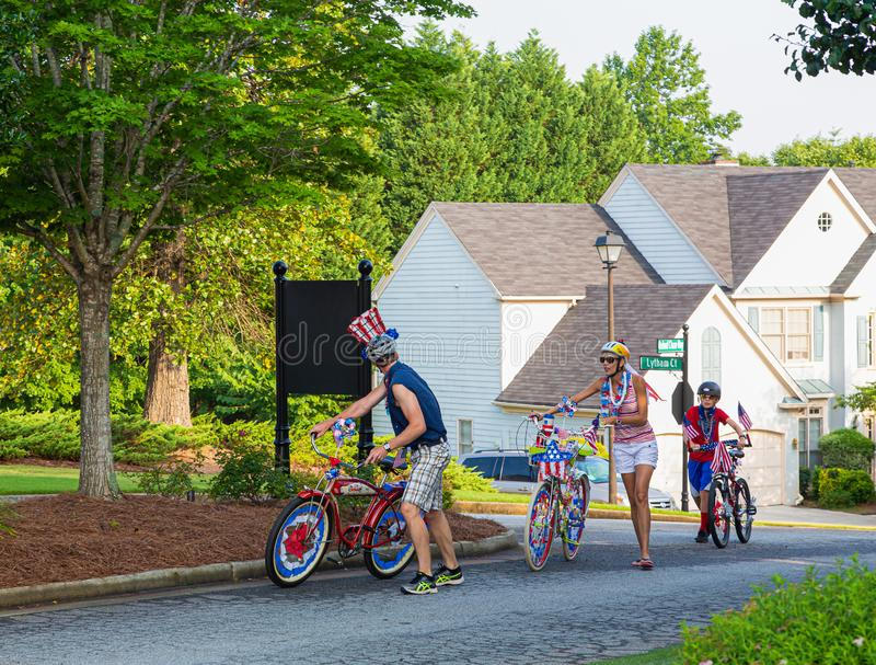 Family Cycling to Fourth of July Parade stock images