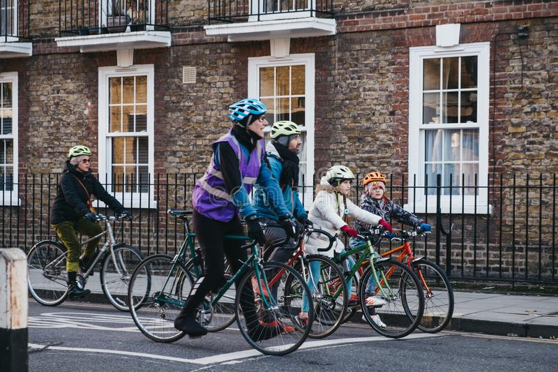 Family of cyclists on a street in Haringey, London, UK royalty free stock photography