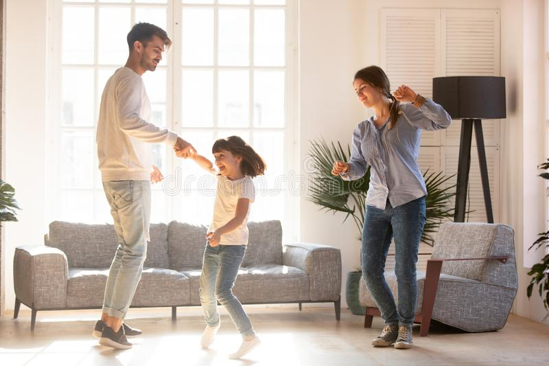 Family dancing in living room spending time on weekend together royalty free stock photos