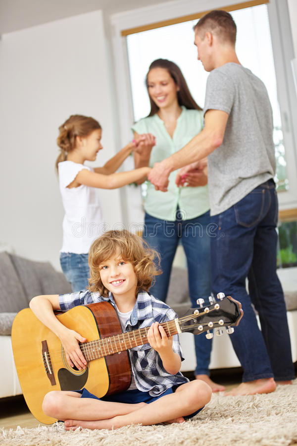 Family dancing and making music. Together at home stock photography