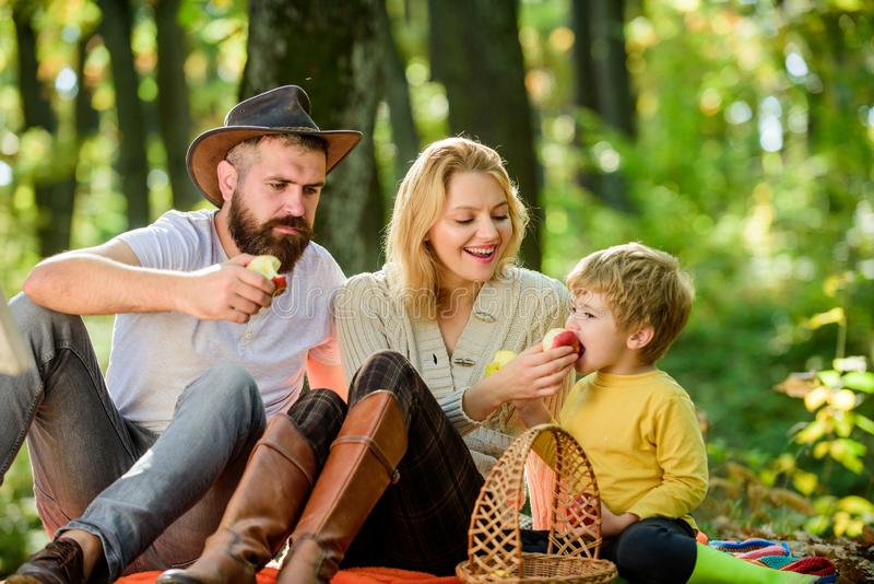 Family day concept. Happy family with kid boy relaxing while hiking in forest. Family weekend. Mother father and little stock photo