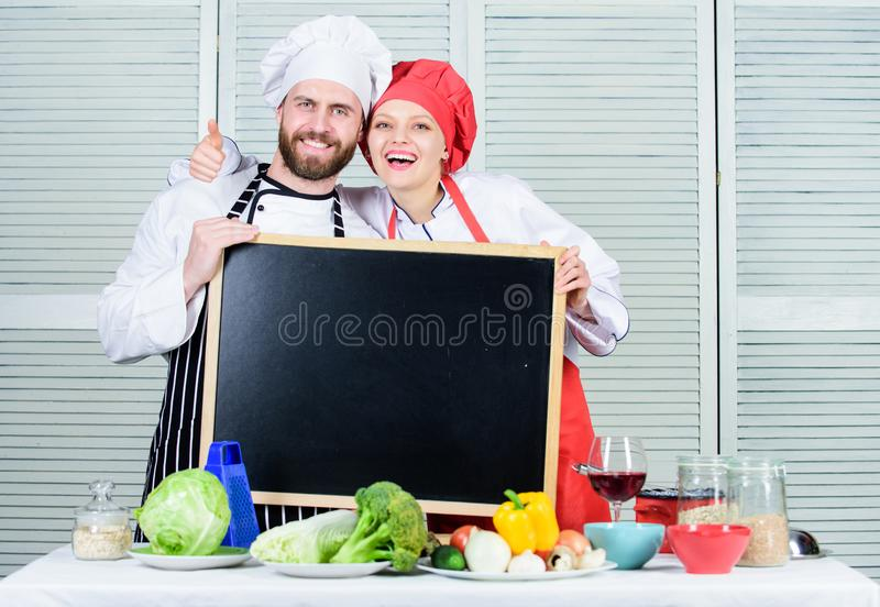 Family day. Couple in love cooking together. Family values. Share joy. Man and woman chef cooking food together. Couple stock images