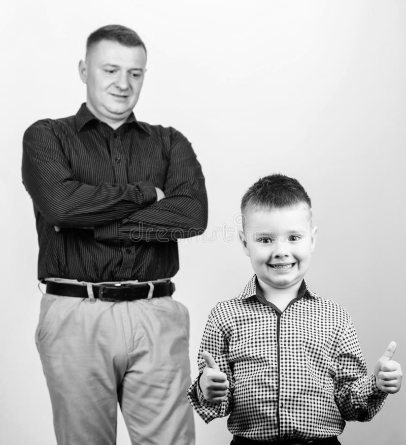 Family day. happy child with father. business partner. father and son in business suit. fashion. trust values. fathers. Day. small boy with dad businessman royalty free stock image