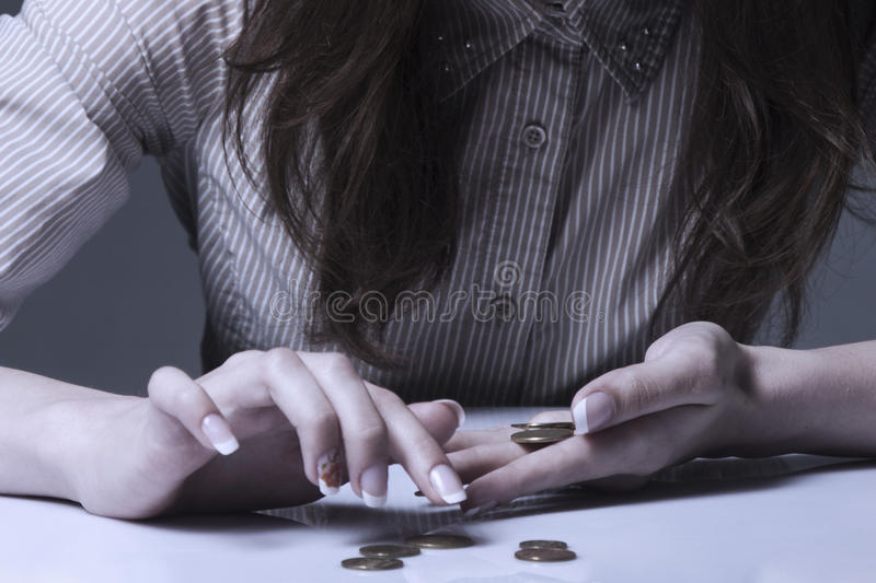Family debts. Young frustrated and desperate Woman counting small money (Bankrupt, poverty, tax, money concept) stock images