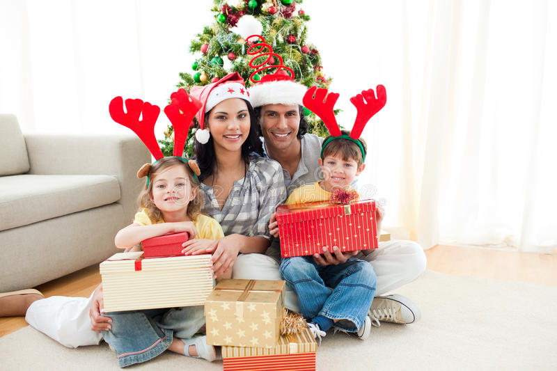 Download Family Decorating A Christmas Tree Stock Image - Image: 11943303