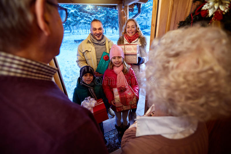Family delivering presents at Christmas royalty free stock photos