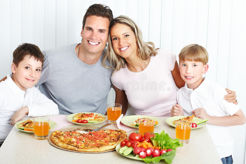 Family dinner. Father, mother and children eating a big pizza