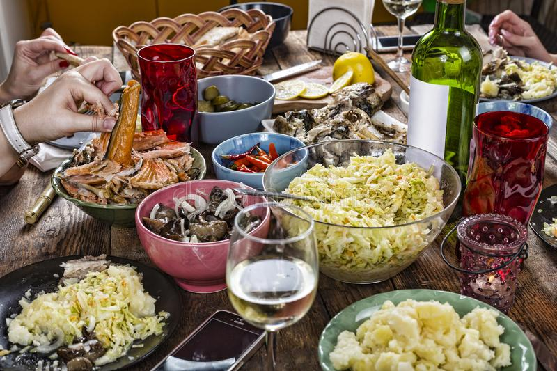 Dinner table, dinner, snack, food, healthy, rustic, salad,eating outdoors, Family, appetizers, Close up,. Family dinner variety of Italian dishes with glass of royalty free stock photos