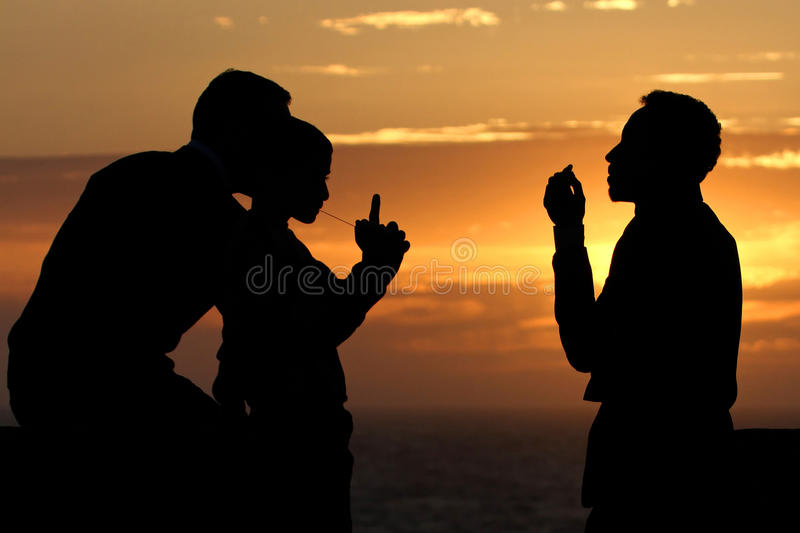 Family discussion at sunset. Unidentified family discussing at sunset on the ramparts, in Essaouira, Morocco on May 11, 2013. Essaouira is one of the most stock photo