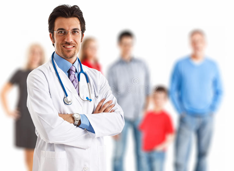 Family doctor: doctor with a family in the background stock photo