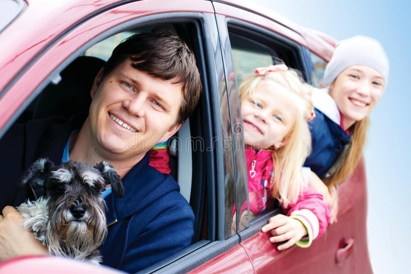 Family with a dog in the car royalty free stock photography