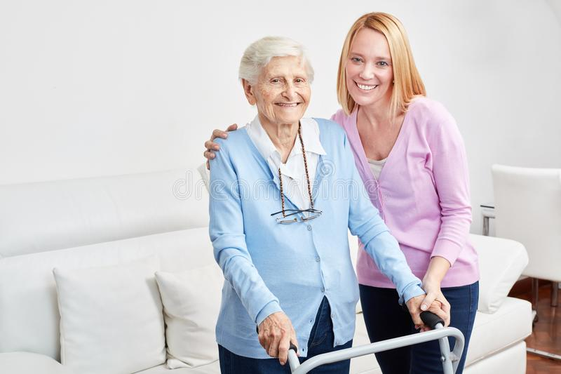 Family makes home care with senior citizen stock images