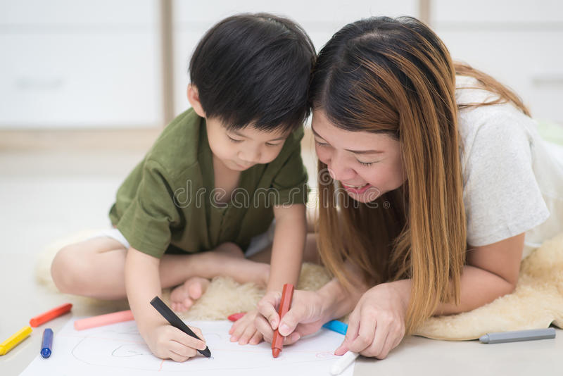 Family drawing picture. Asian family drawing picture with crayons stock photos