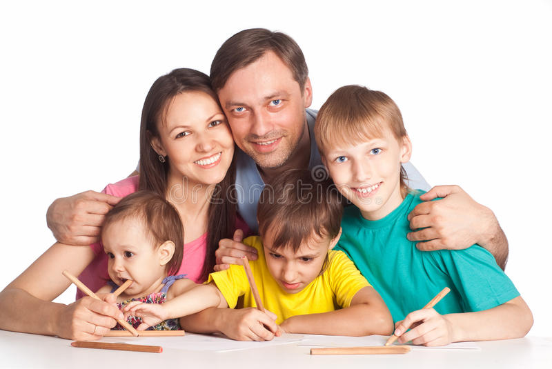 Family drawing at table. Nice family drawing at table on white royalty free stock photo