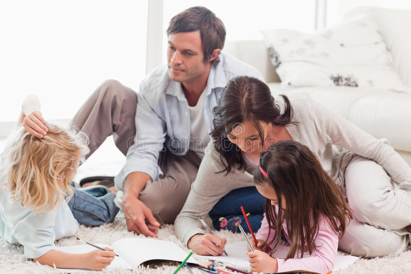 Family drawing together. In a living room royalty free stock photos