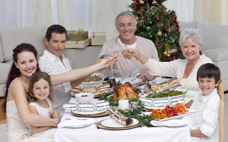 Family drinking a toast in a Christmas dinner stock photo