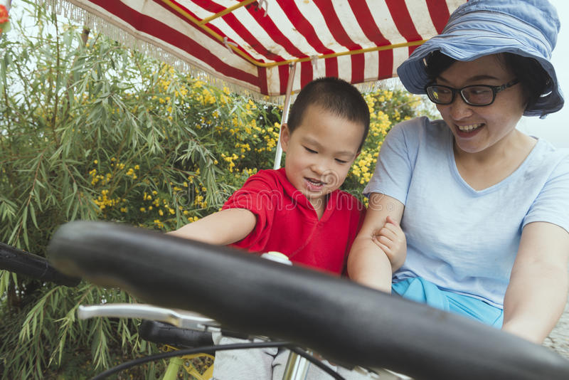 Family driving bicycle stock photography