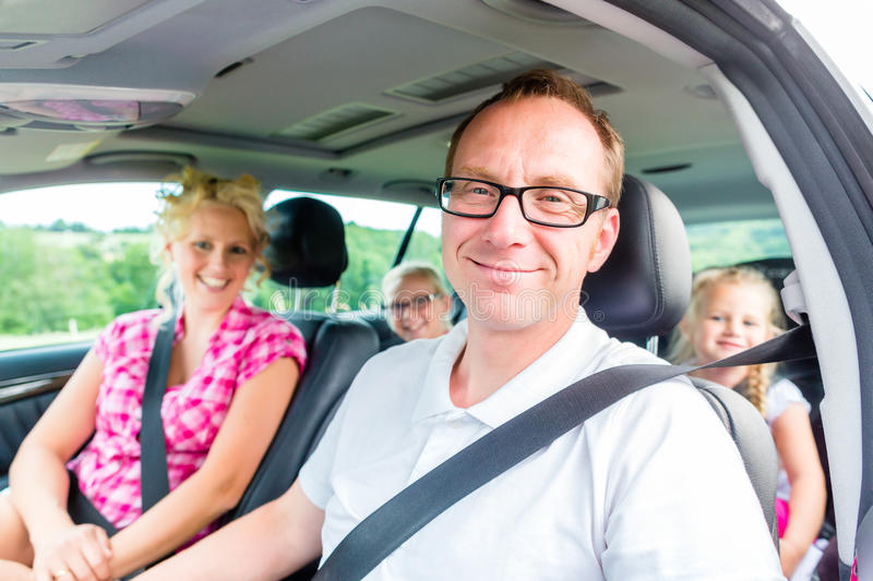 Family driving in car with seat belt. Fastened stock image